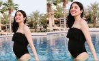 Anushka Sharma Flaunts her Baby Bump in Black Swimsuit