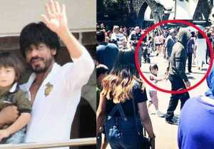 Shahrukh Khan seen HIDING FACE while walking with AbRam in USA