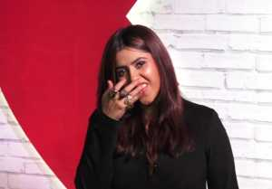 Ekta Kapoor cleans Lipstick from her teeth in front on Media; Watch Video