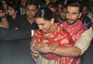 Ranveer Singh PROTECTS Deepika Padukone from crowd; Watch Video