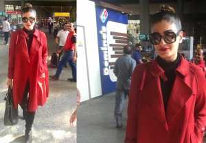 Raveena Tandon looks stylish and trendy in red long coat