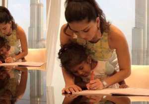 Sunny Leone helps her daughter Nisha in homework during Dubai vacation