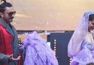 Deepika Padukone's husband Ranveer Singh adjust her gown during IIFA awards; Check out