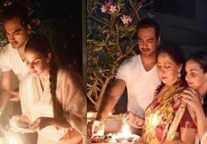 Esha Deol lights up diya with mother Hema & husband Bharat Takhtani