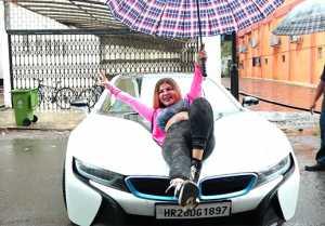 Rakhi Sawant enjoys rain while dancing on top of BMW Car  ; Watch Video