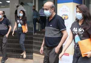 Rhea Chakraborty spotted with father outside bank; Watch video