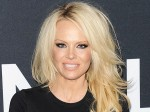 Pamela Anderson Tries To Bring Smile And Help To Wikileaks Founder Julian Assange