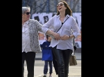Anne Hathaway And Chrissy Teigen Show Off Their Baby Bumps