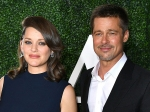 Marion Cotillard Opens Up About Her Steamy Scene With Brad Pitt In All