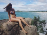 Bruna Abdullah Sports A Bikini And Chills Atop A Rock By The Beach
