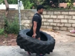 Golden Star Ganesh Lifts Tyre Like Baahubali