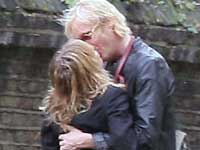 Rhys Ifans and Sienna Miller kissing