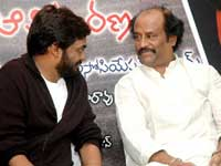 Rajini and Puri Jagannath at the audio launch
