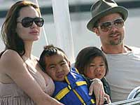 Jolie and family with Paul Allens yacht in France
