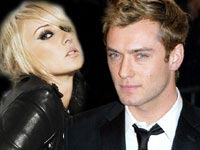 Jude Law and Kimberly Stewart kissing
