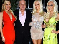 Hugh Hefner with his playmates