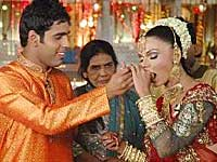http://entertainment.oneindia.in/img/2009/07/21-rakhi-manas-210709.jpg