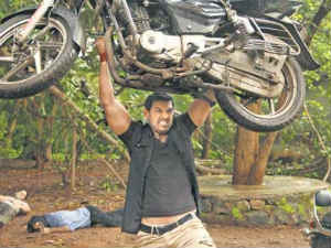 John Abraham lifting bike