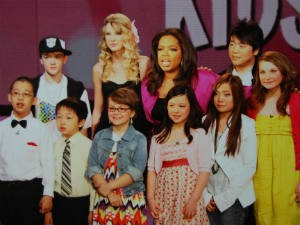 Taylor Swift and Oprah Winfrey with young fans