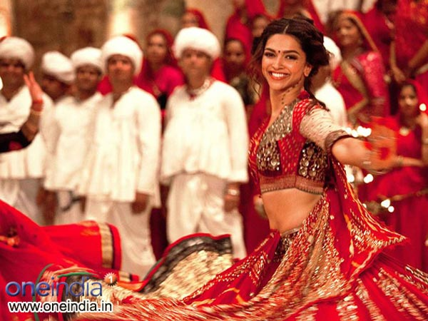 Deepika Sizzles In Red Lehenga
