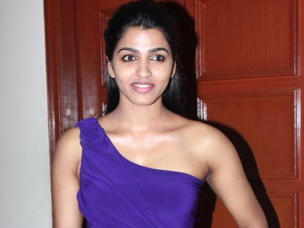 Dhansika Poses In Purple Gown