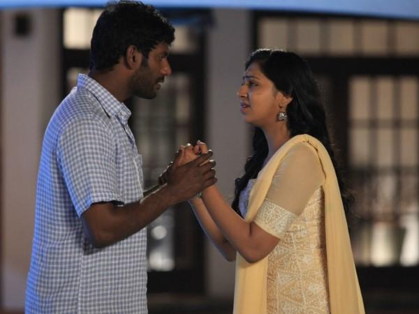 Naan Sigappu Manithan Review - Filmibeat Naan Sigappu Manithan Lakshmi Menon Lip Lock