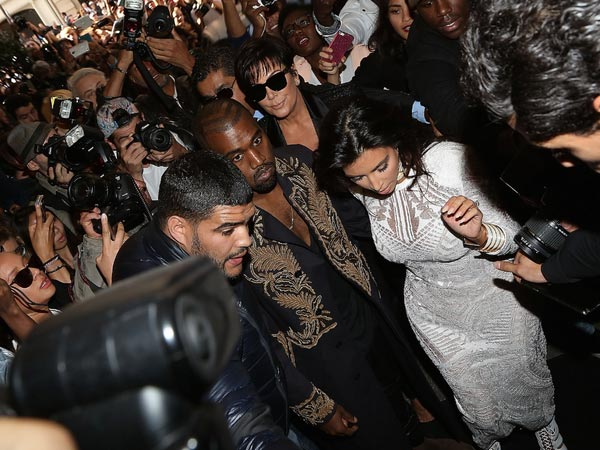 Watch: Kim Kardashian Attacked By Prankster At Paris Fashion Week