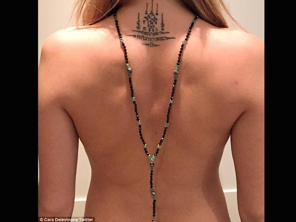 Cara Delevingne Goes Topless, Posts Photo Online