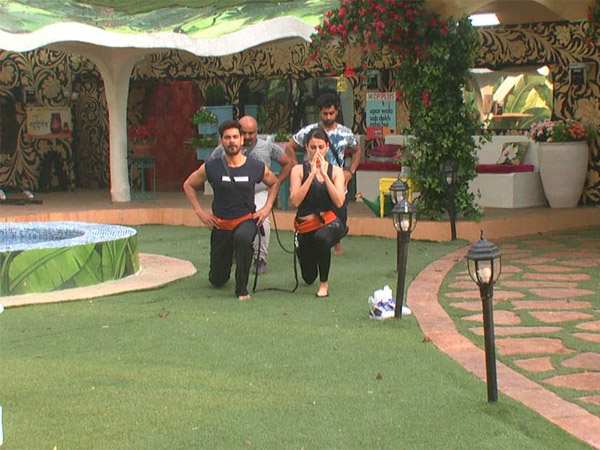 Housemates Performing Yoga
