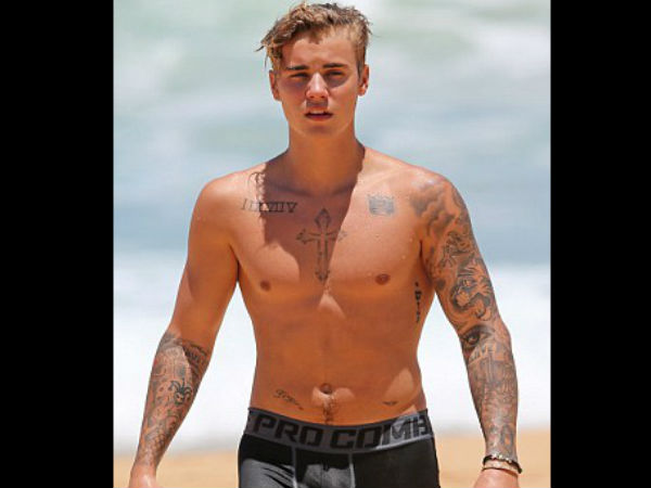 Justin bieber 39 s new tattoo a pair of angles wings on the for Justin bieber new tattoo