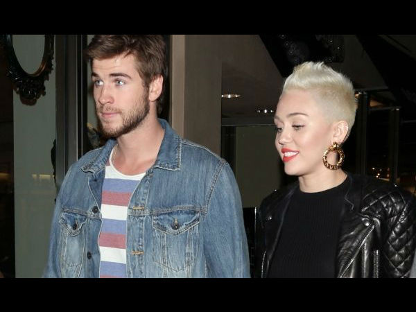 Miley Cyrus and Liam Hemsworth have moved in together. Miley Cyrus seen with an engagement ring her