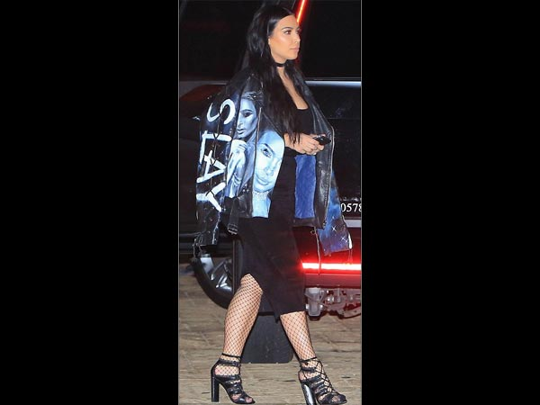 Narcissistic Much? Kim Kardashian Wears A Jacket With Her Own Face Printed On It!
