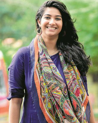 Meet dulquer salmaan 39 s new leading lady karthika for C k muraleedharan
