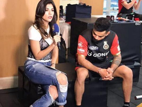 Virat Kohli Staring At Archana Vijaya's Legs Goes Viral! But Is He Really Staring At Her Legs?