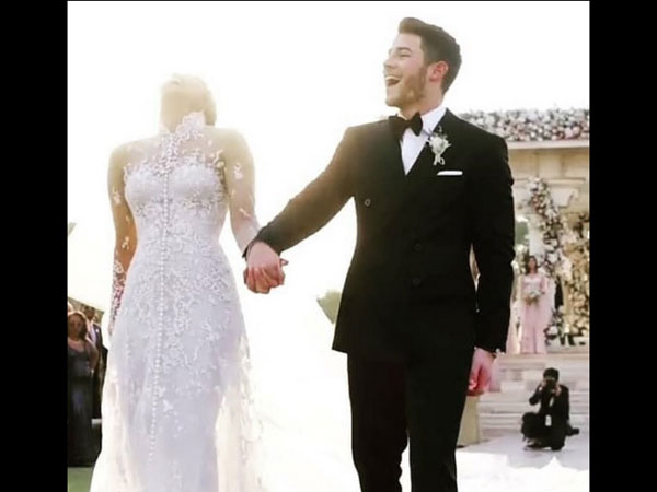 Details About Nick Jonas' Wedding Outfit