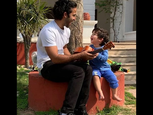 Taimur Ali Khan Soaks In Some Sun & Plays Unkulele; His Video Is The Cutest Thing On The Internet!