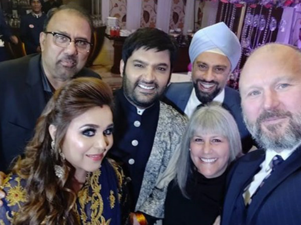 Kapil Posing With Guests