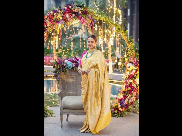 Surveen Glows In A Yellow Sari