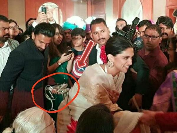 CAUGHT ON CAMERA! Ranveer Singh Carries Deepika Padukone's SANDALS In Hands At Her Cousin's Wedding!