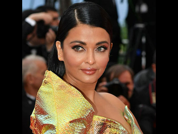 SCARY & AWFUL! Aishwarya Rai Bachchan Gets DISSED For Her Cannes Golden Gown; Fans Are Disappointed