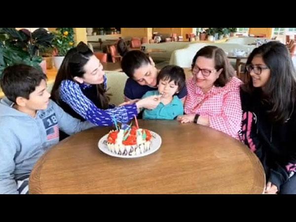 This Photo Of Taimur Ali Khan Enjoying Karisma Kapoor's Birthday Cake Is All Things Cute!