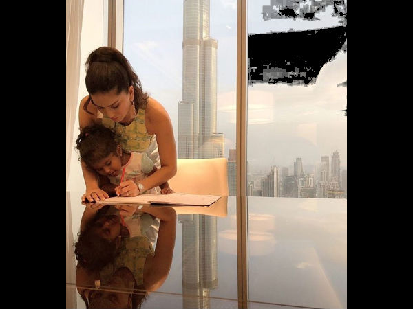 PIC: Sunny Leone Helps Her Daughter Do Homework While On Vacation; Parenting Done Right!