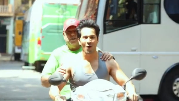 Varun Dhawan Retorts Sarcastically When A Troller Calls Him Out For Riding A Scooter Without Helmet