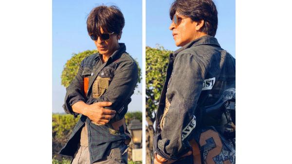Shah Rukh Khan Flaunts A Jacket Gifted By Karan Johar, Hilariously Demands A Pair Of Heels!