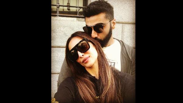Pic Talk: Arjun Kapoor Gives Malaika Arora A Kiss Of Love