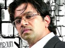 https://www.filmibeat.com/img/2009/03/09-arjun-090309.jpg