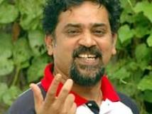 https://www.filmibeat.com/img/2009/11/04-santhosh-sivan-041109.jpg