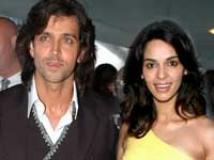 https://www.filmibeat.com/img/2009/11/05-hrithik-mallika-051109.jpg