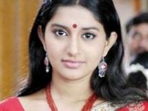 https://www.filmibeat.com/img/2009/11/06-meera-jasmine-100408.jpg