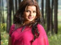 https://www.filmibeat.com/img/2009/12/05-madhu-sharma-210508.jpg